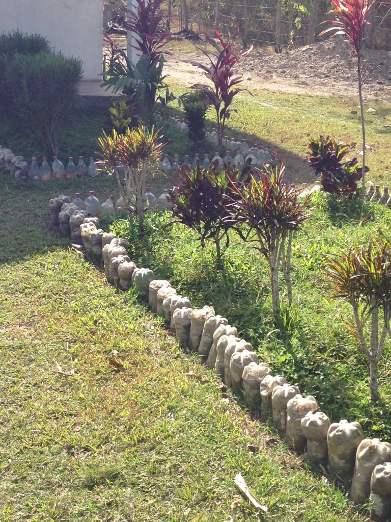 Garden edging with soda bottles